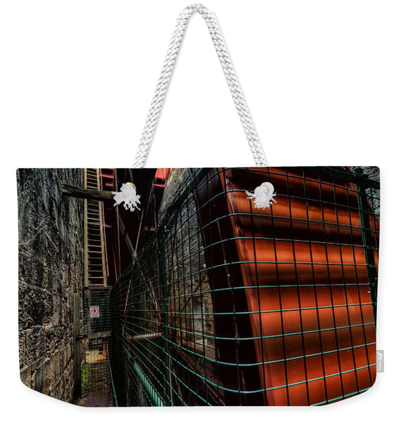 British Weekender Tote Bag featuring the photograph The Big Wheel by Adrian Evans