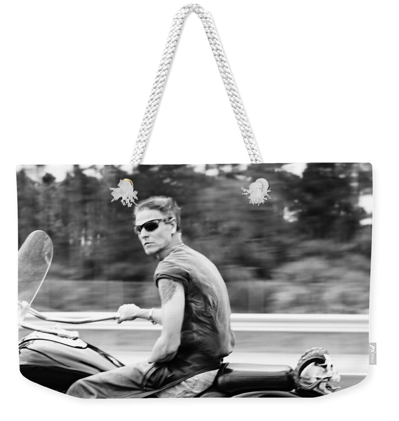 Biker Weekender Tote Bag featuring the photograph The Biker by Laura Fasulo
