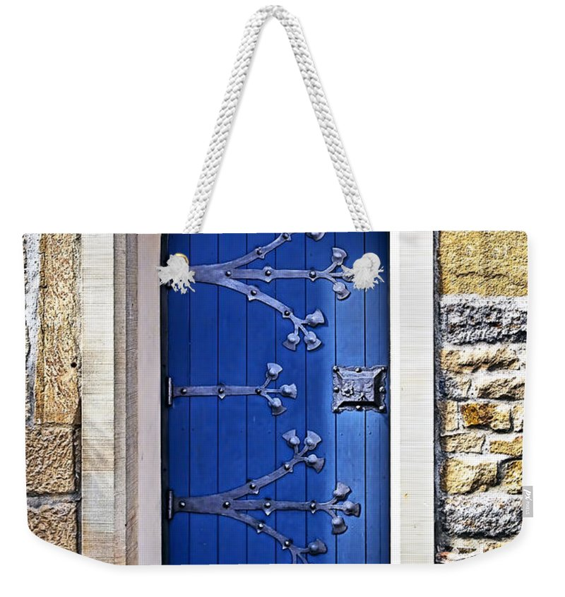 Architecture Weekender Tote Bag featuring the photograph The Blue Door by Marcia Colelli