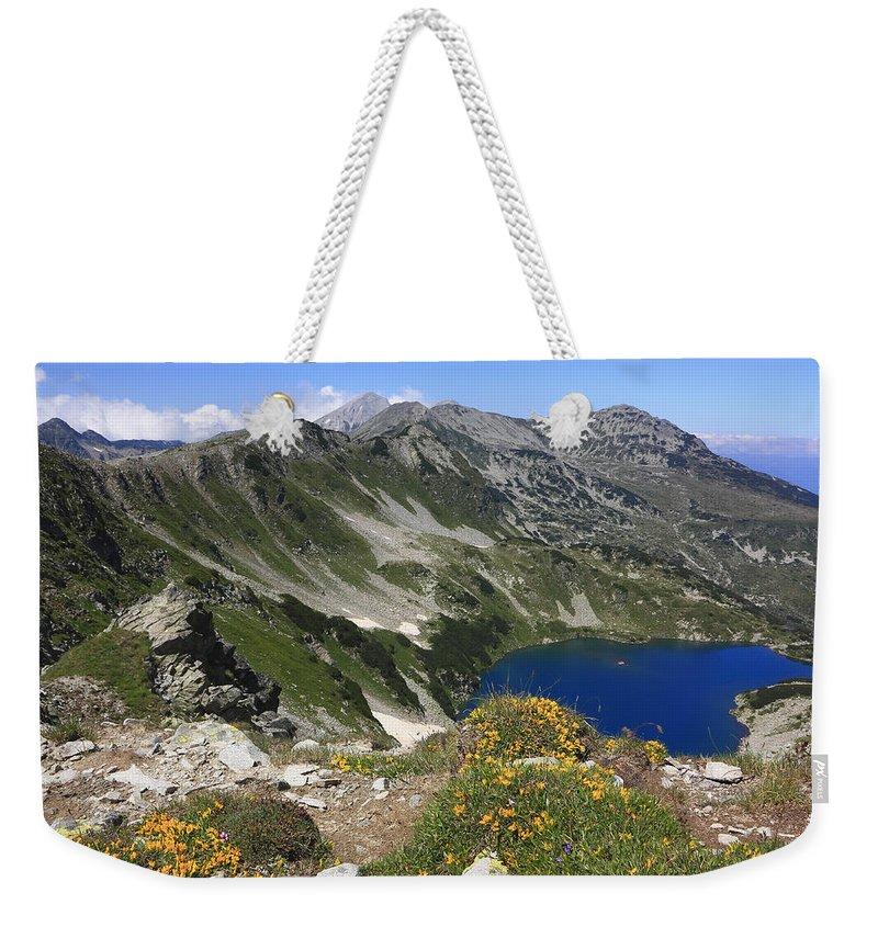 Balkan Peninsula Weekender Tote Bag featuring the photograph The Blue Vasilashko Lake Pirin National Park Bulgaria by Ivan Pendjakov
