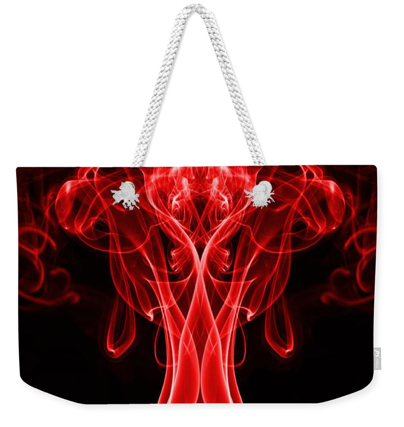 Smoking Trails Weekender Tote Bag featuring the photograph The Bodybuilder by Steve Purnell