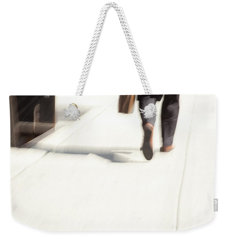 Walking Weekender Tote Bag featuring the photograph The Businessman by Karol Livote