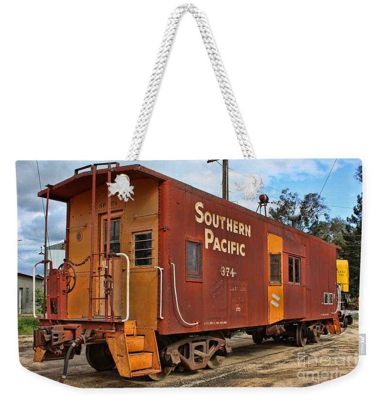Railroad Weekender Tote Bag featuring the photograph The Caboose by Tommy Anderson