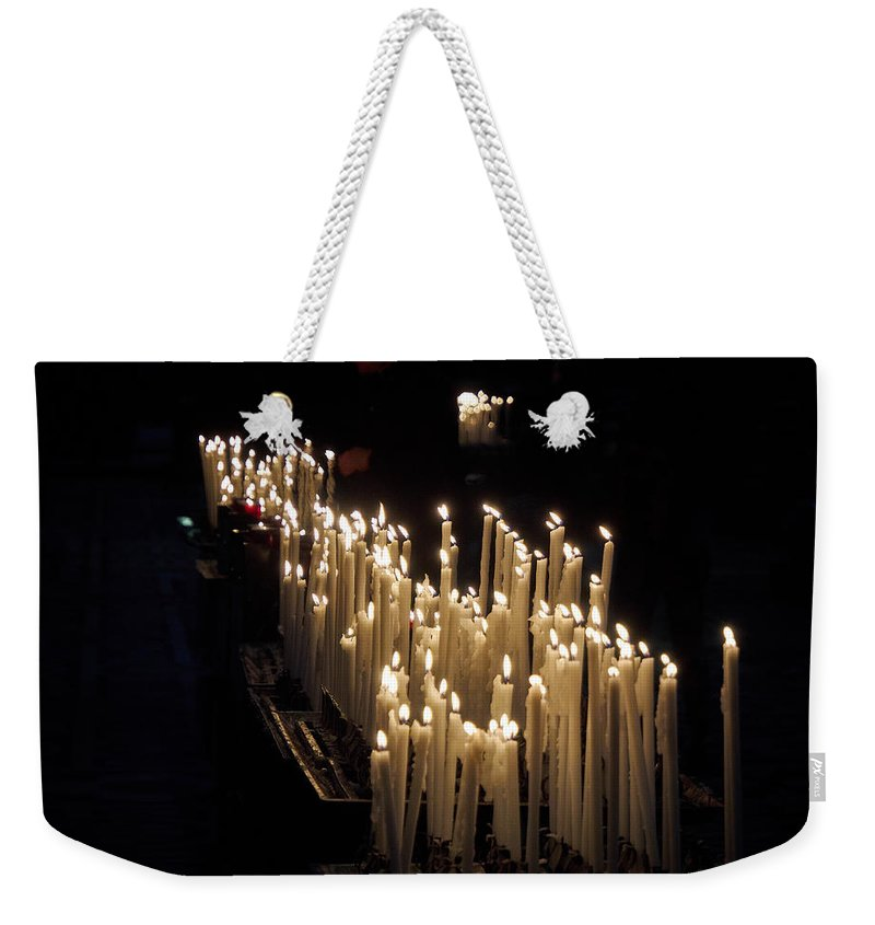Francacorta Weekender Tote Bag featuring the photograph The Candles. Duomo. Milan by Jouko Lehto