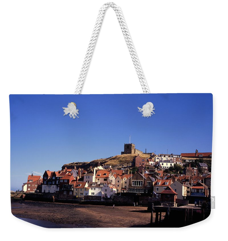 Whitby North Yorkshire England Abbey English British Town Towns Villages Village Autumn The Fall Coast Coastline Coasts Holiday Resort Resorts Tourist Tourism Tourists Holiday Holidays Trip Trips Visit Visits Leisure Recreation Sea Seaside Vacation Vacations Seaside Coastal Church Churches Weekender Tote Bag featuring the photograph The Church Of St Mary's And Whitby Abbey North Yorkshire England by Michael Walters
