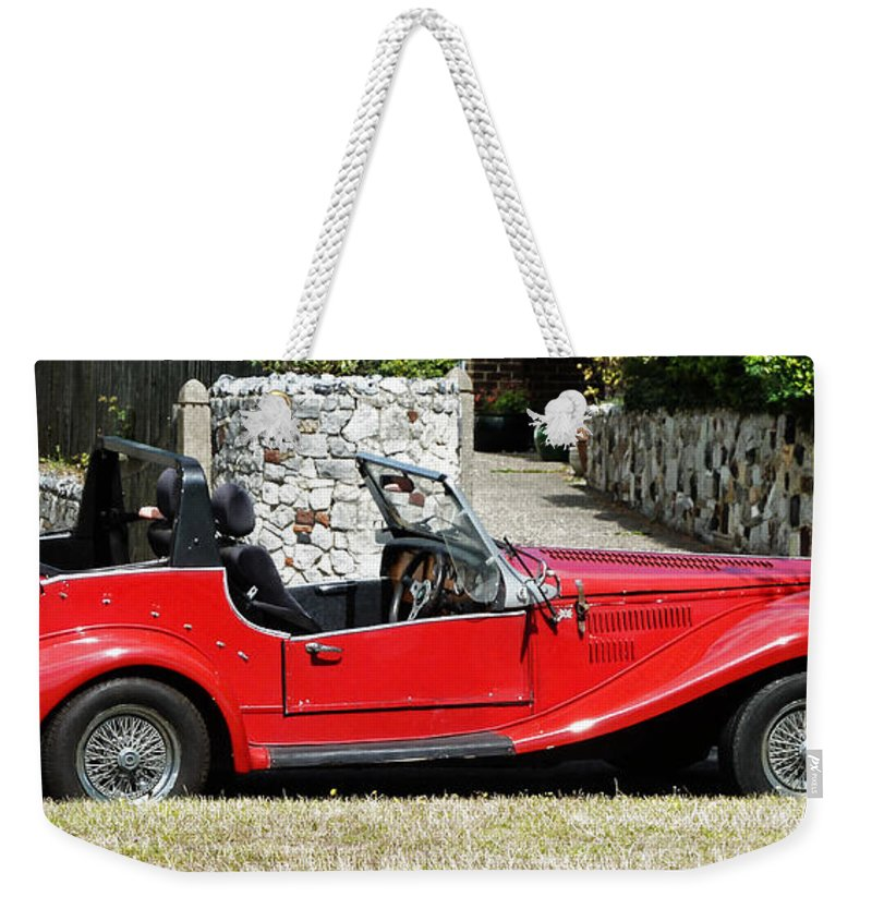 Red Weekender Tote Bag featuring the photograph The Classic Red Convertible by Steve Taylor