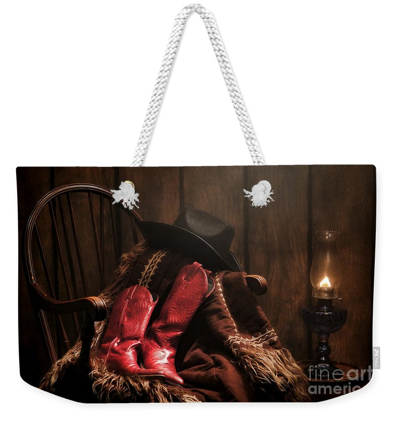 Cowgirl Boots Weekender Tote Bag featuring the photograph The Cowgirl Rest by Olivier Le Queinec