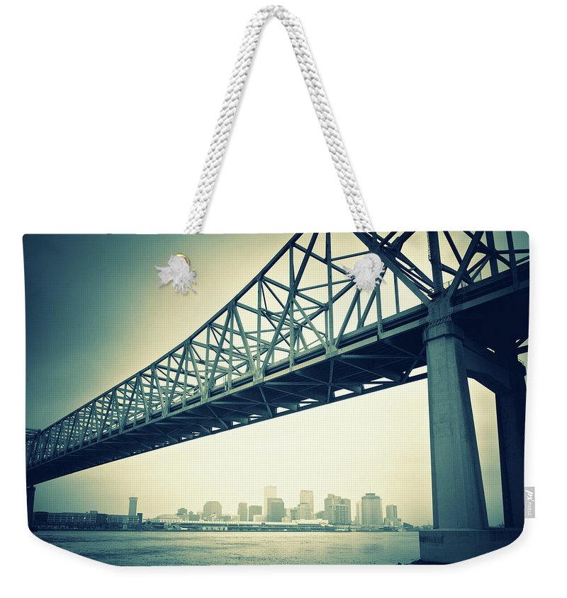 Desaturated Weekender Tote Bag featuring the photograph The Crescent City Connection In New by Moreiso