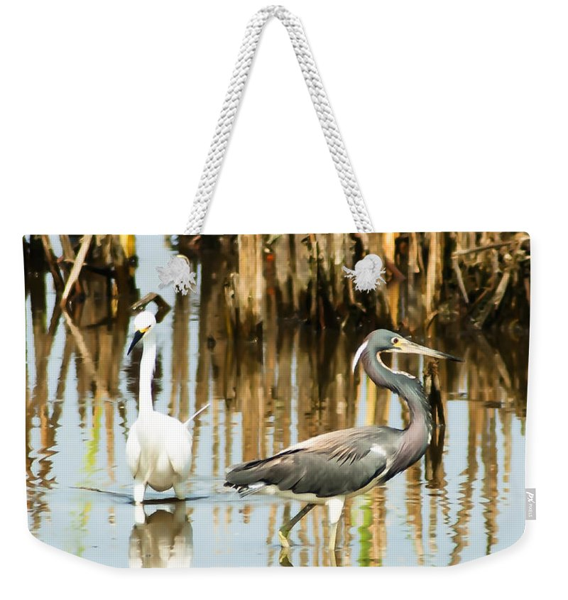 Tricolored Heron Weekender Tote Bag featuring the photograph The Dance by Norman Johnson