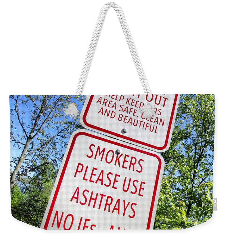 Fishing Weekender Tote Bag featuring the photograph The Death Of The Messy Smoking Fisherman by Olivier Le Queinec
