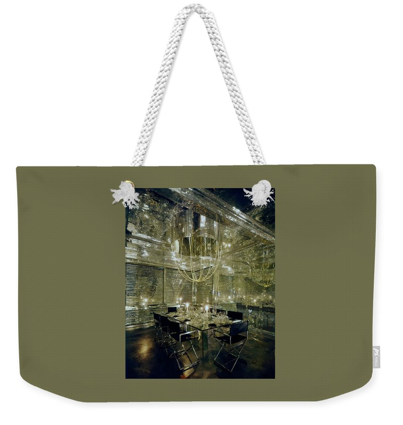 Decorative Art Weekender Tote Bag featuring the photograph The Dining Room Of Ara Gallant's Apartment by William Grigsby