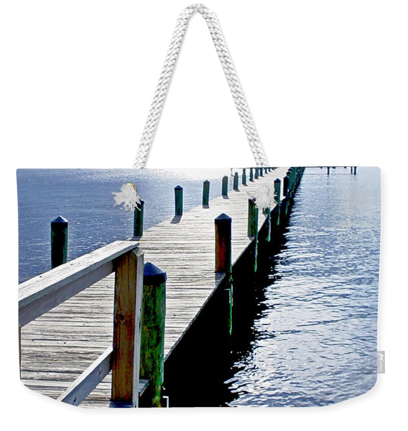 Seascape Weekender Tote Bag featuring the photograph The Dock Of The Bay by Norman Johnson