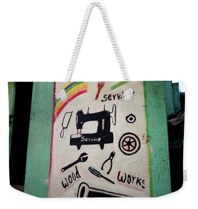 Kitsch Weekender Tote Bag featuring the photograph The Entrepreneur by Shaun Higson