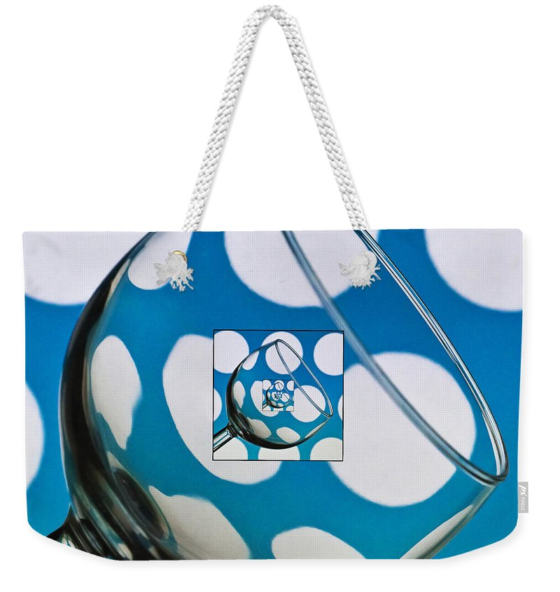 Wine Glass Weekender Tote Bag featuring the photograph The Eternal Glass Light Blue by Steve Purnell