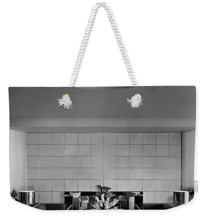 Interior Weekender Tote Bag featuring the photograph The Executive Lounge At The Ford Exposition by Robert M. Damora