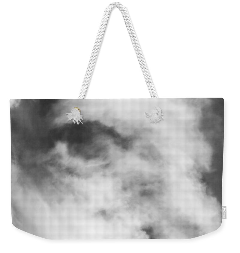 Cloud Weekender Tote Bag featuring the photograph The Face In The Clouds by Michael Moriarty