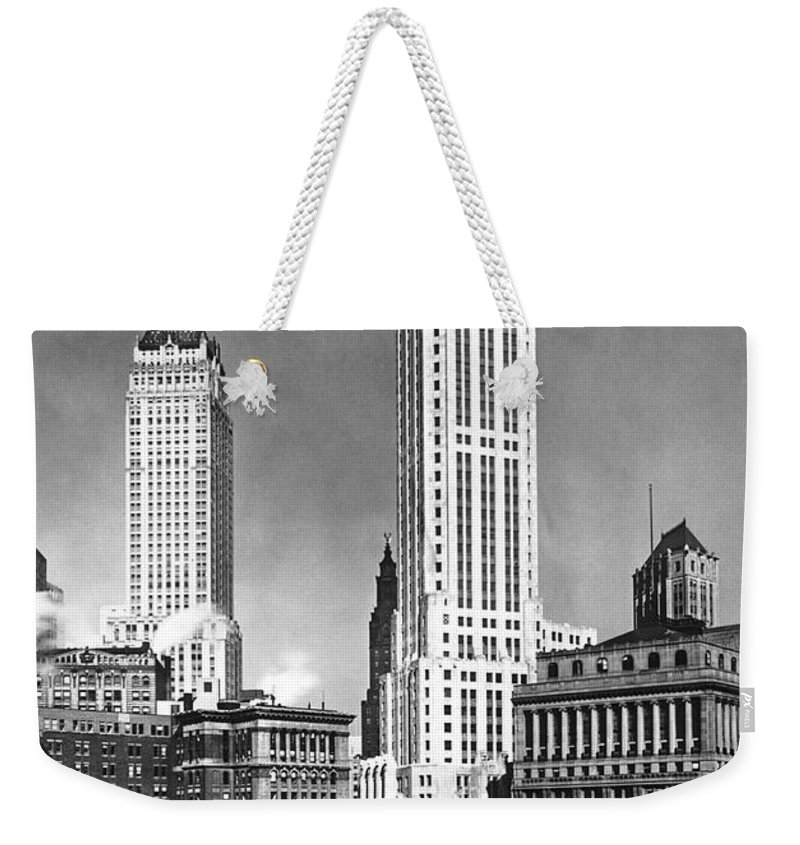 1932 Weekender Tote Bag featuring the photograph The Farmers Trust Building by Underwood Archives