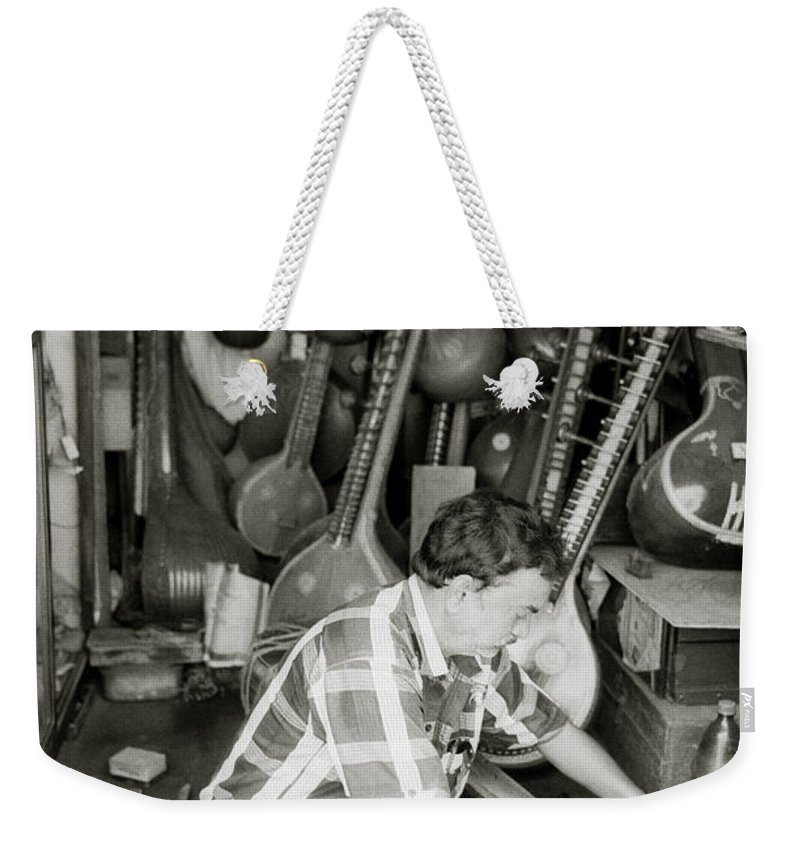 India Weekender Tote Bag featuring the photograph The Fixer by Shaun Higson