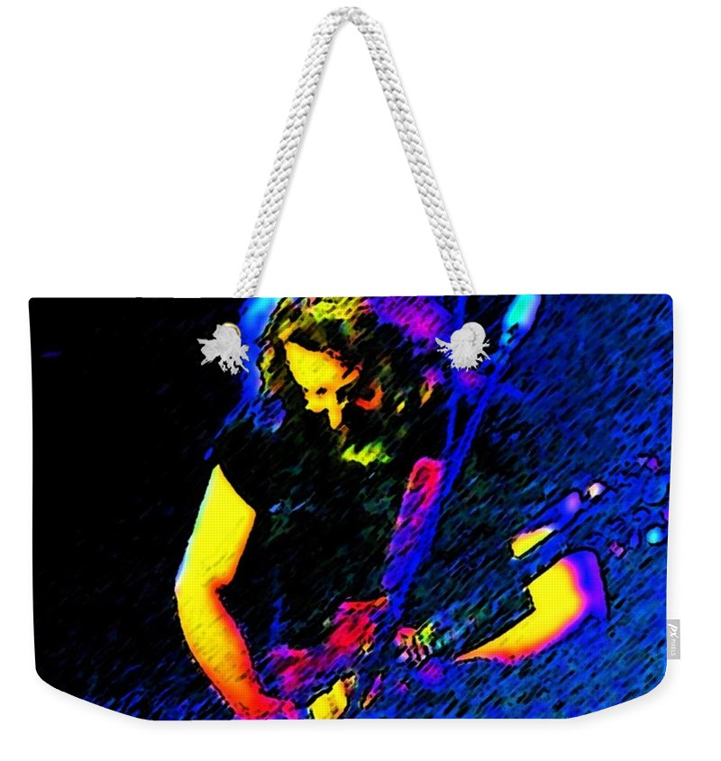 Music Weekender Tote Bag featuring the photograph The Four Winds by Susan Carella
