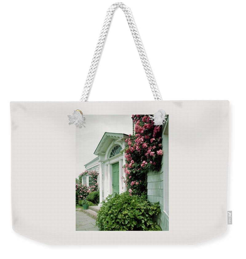 Mr. A. Stuart Walker Weekender Tote Bag featuring the photograph The Front Of Mr. And Mrs. A Stuart Waler's Home by Tom Leonard