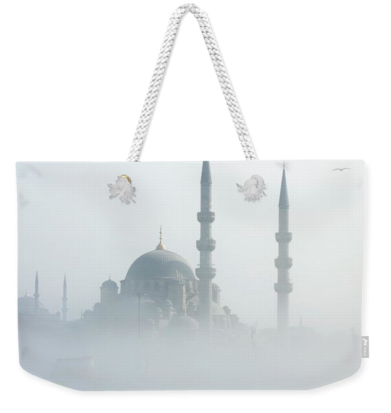 Istanbul Weekender Tote Bag featuring the photograph The Galata Bridge Leads Across Golden by Jazzirt