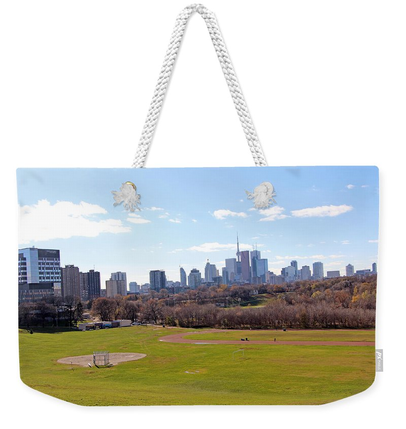 Toronto Weekender Tote Bag featuring the photograph The Game by Munir Alawi