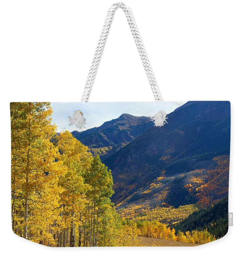 Autumn Colors Weekender Tote Bag featuring the photograph The Golden Gate by Jim Garrison