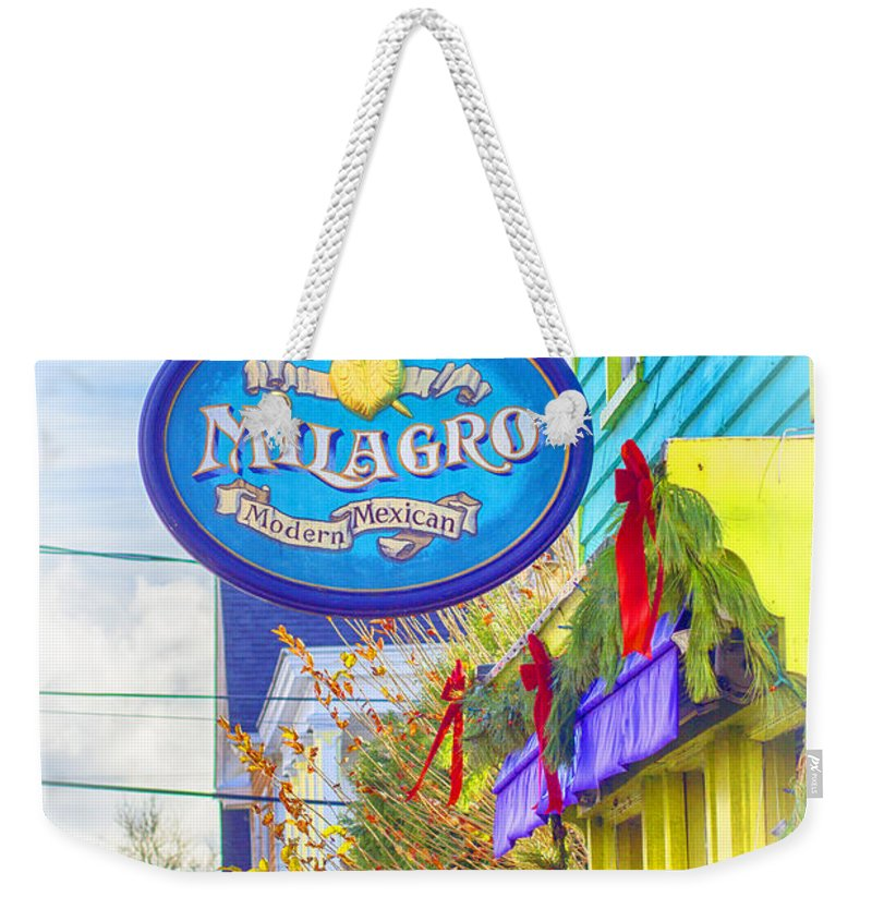 Milagro Weekender Tote Bag featuring the photograph The Good Stuff by Joe Geraci