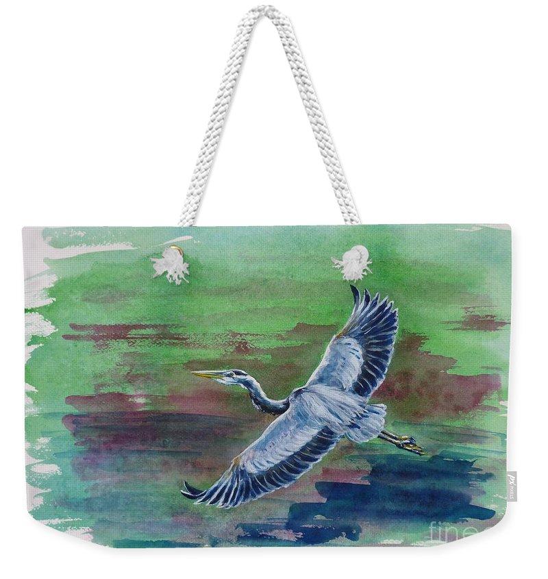 Great Blue Heron Weekender Tote Bag featuring the painting The Great Blue Heron by Zaira Dzhaubaeva