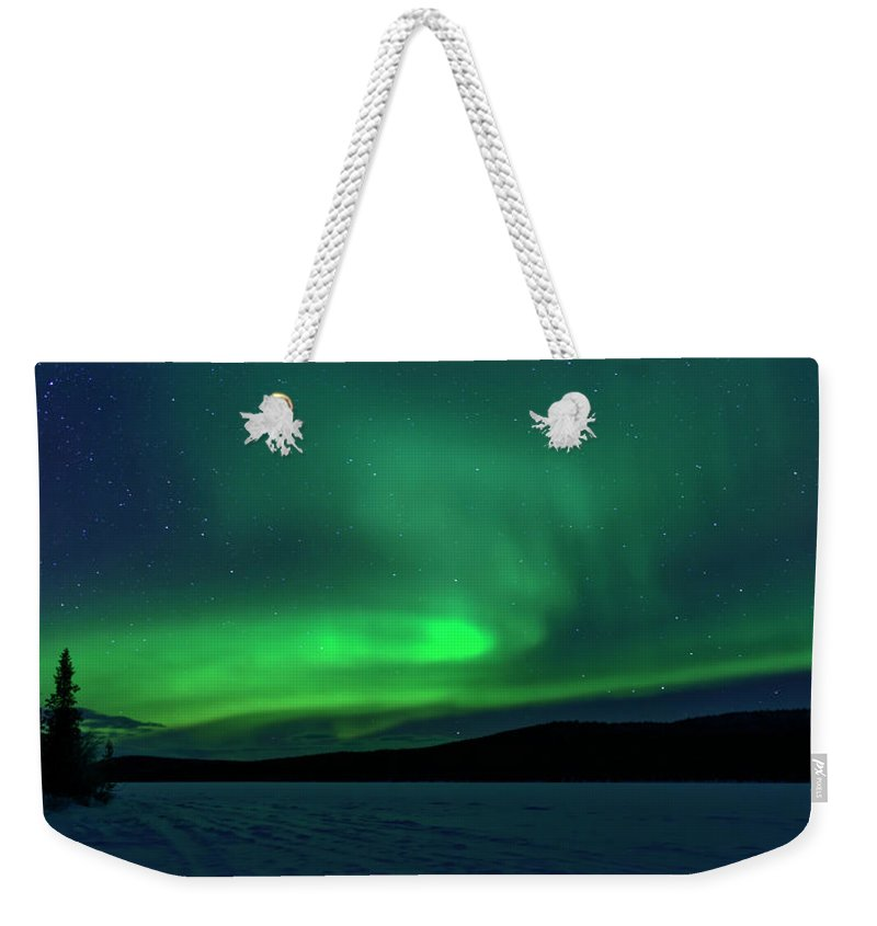 Snow Weekender Tote Bag featuring the photograph The Green Light Of The Aurora by Dave Moorhouse