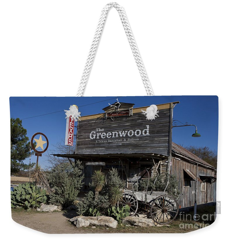 The Greenwood Weekender Tote Bag featuring the photograph The Greenwood Dancehall And Saloon Bluff Dale Texas by Jason O Watson
