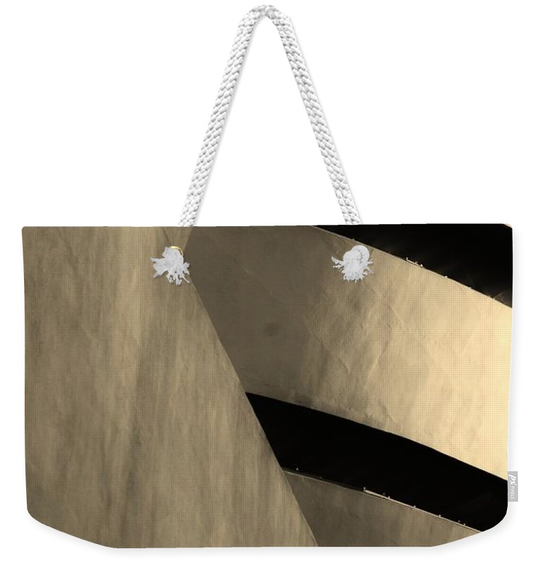 Scenic Weekender Tote Bag featuring the photograph The Guggenheim In Sepia by Rob Hans