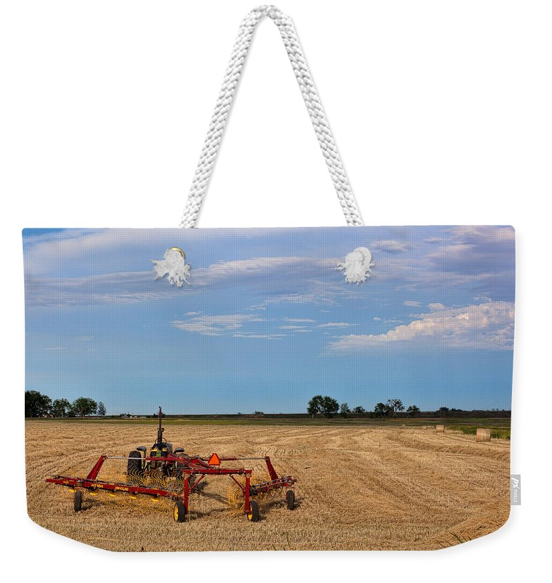 Hay Rake Photograph Weekender Tote Bag featuring the photograph The Hayfield by Jim Garrison
