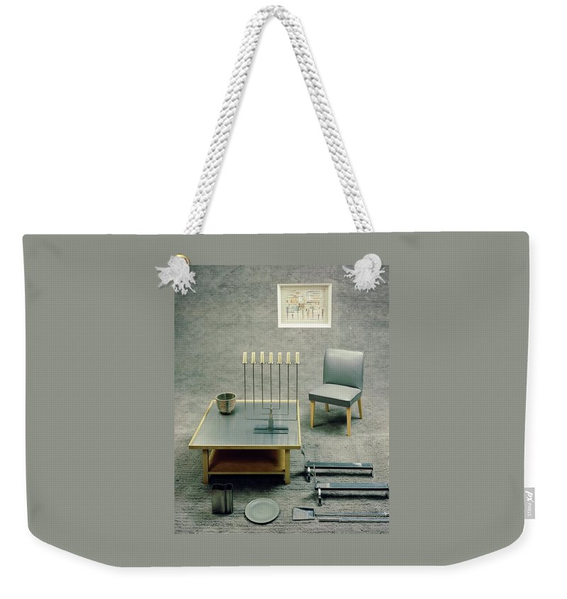 Studio Shot Weekender Tote Bag featuring the photograph The Interior Design Of A Gray Living Room by Haanel Cassidy