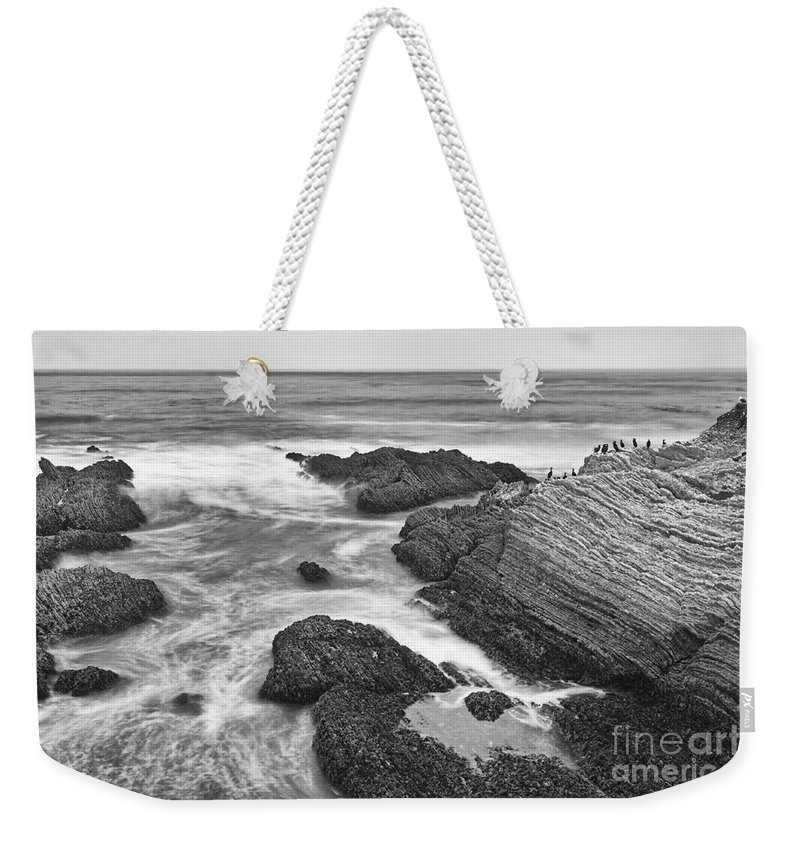 Montana De Oro Weekender Tote Bag featuring the photograph The Jagged Rocks And Cliffs Of Montana De Oro State Park In California In Black And White by Jamie Pham