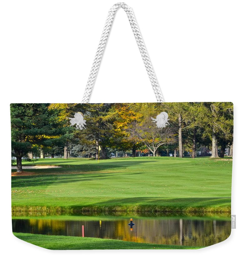 Tree Weekender Tote Bag featuring the photograph The Layup by Frozen in Time Fine Art Photography
