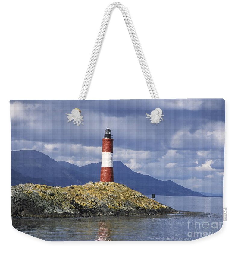 Lighthouse Weekender Tote Bag featuring the photograph The Lighthouse At The End Of The World by James Brunker