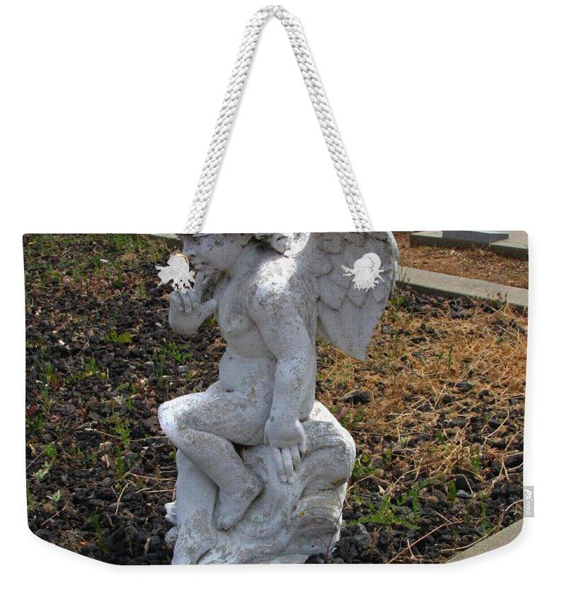 The Little Cherub Weekender Tote Bag featuring the photograph The Little Cherub by Peter Piatt