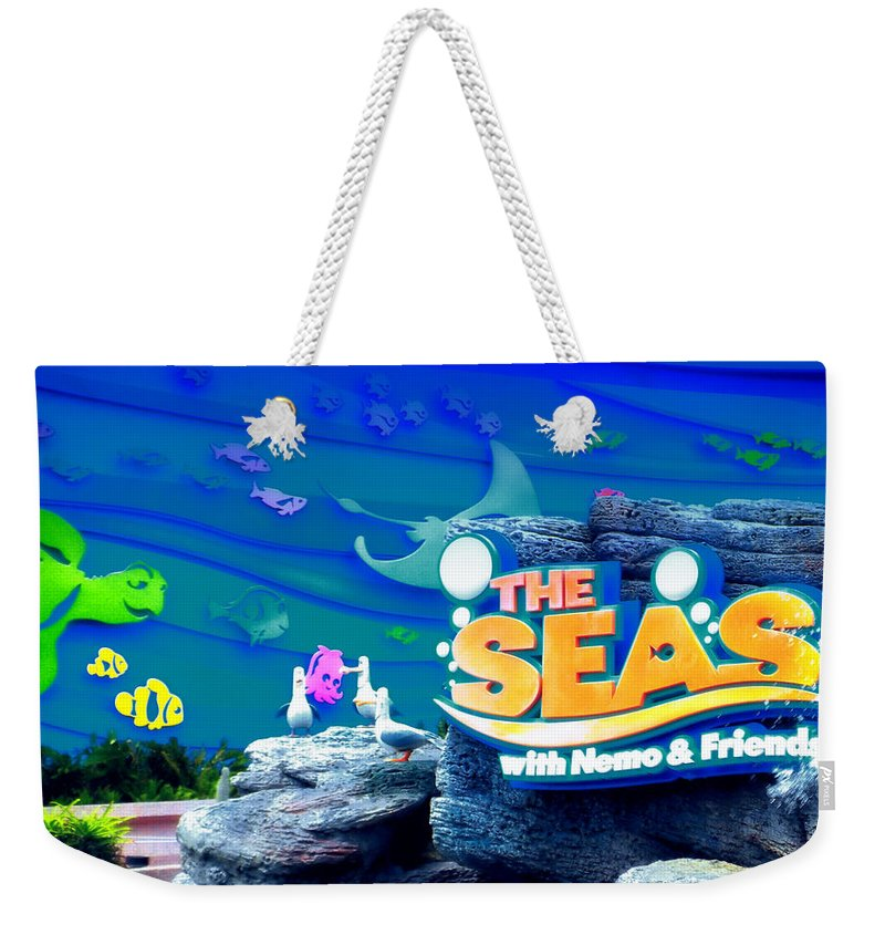 The Living Seas Weekender Tote Bag featuring the photograph The Living Seas Signage Walt Disney World by Thomas Woolworth