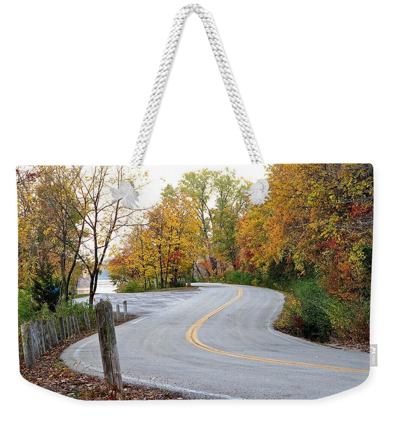 Lake Weekender Tote Bag featuring the photograph The Long And Winding Road by Ken Kobe