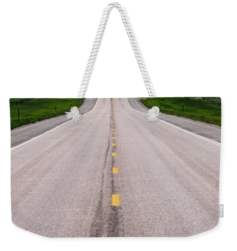 Road Weekender Tote Bag featuring the photograph The Long Road Ahead by Olivier Le Queinec