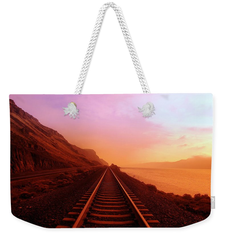 Columbia River Weekender Tote Bag featuring the photograph The Long Walk To No Where by Jeff Swan