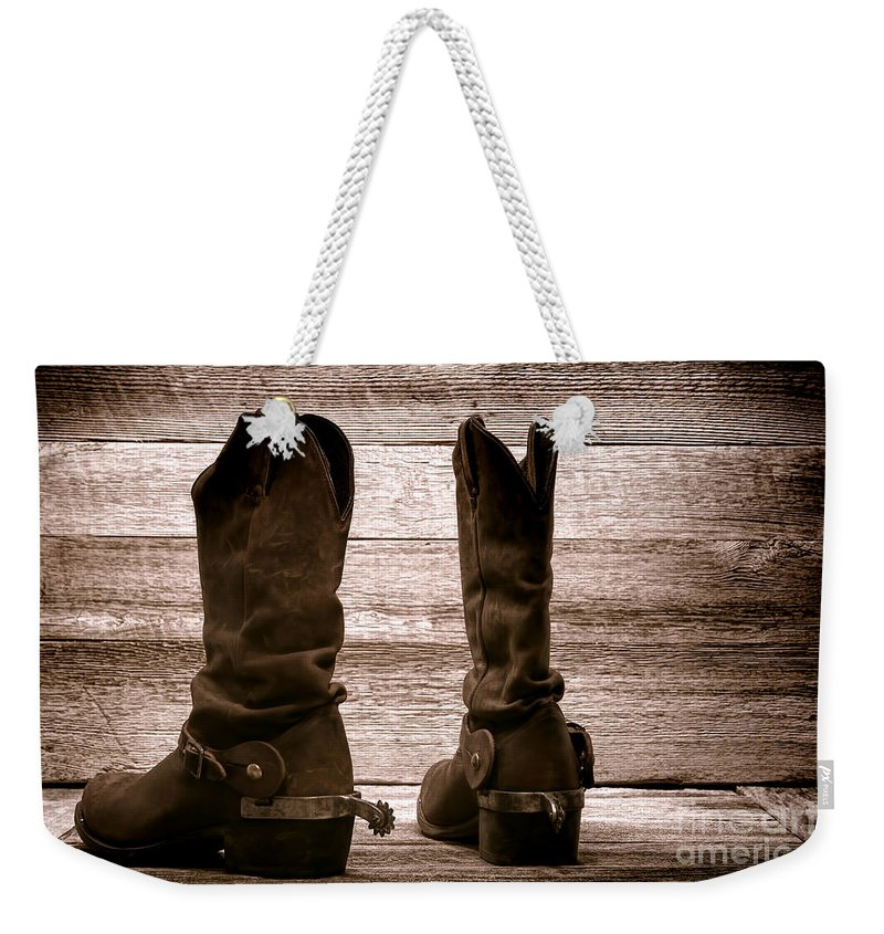 Western Weekender Tote Bag featuring the photograph The Lost Boots by Olivier Le Queinec