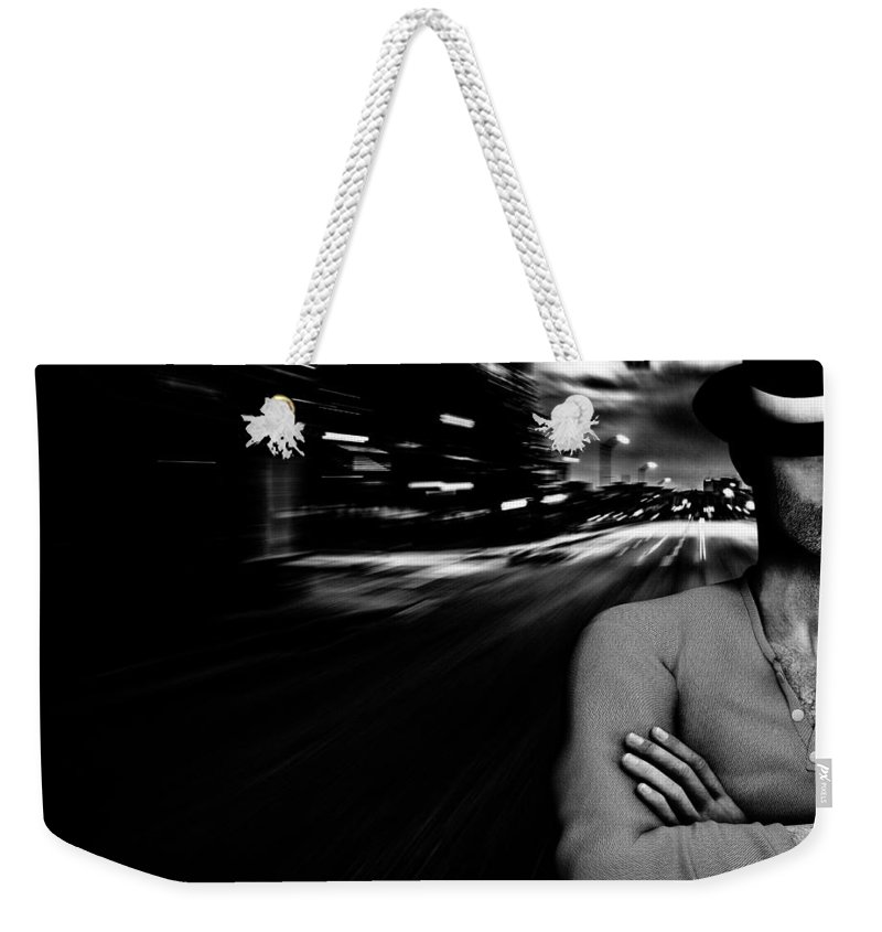 City Weekender Tote Bag featuring the photograph The Man In The Hat Returns by Bob Orsillo