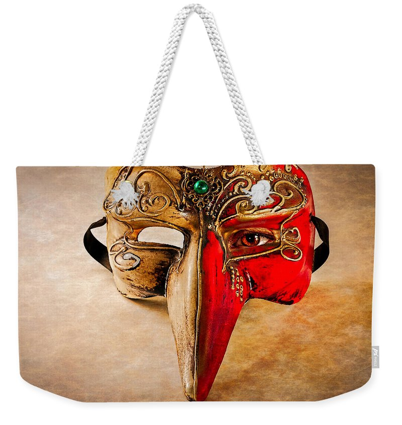 Mask Weekender Tote Bag featuring the photograph The Mask On The Floor by Bob Orsillo