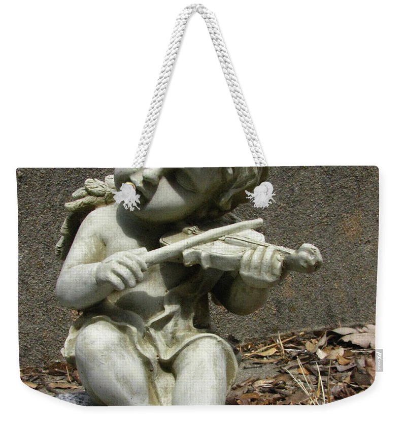 Cupid Weekender Tote Bag featuring the photograph The Musician 03 by Peter Piatt