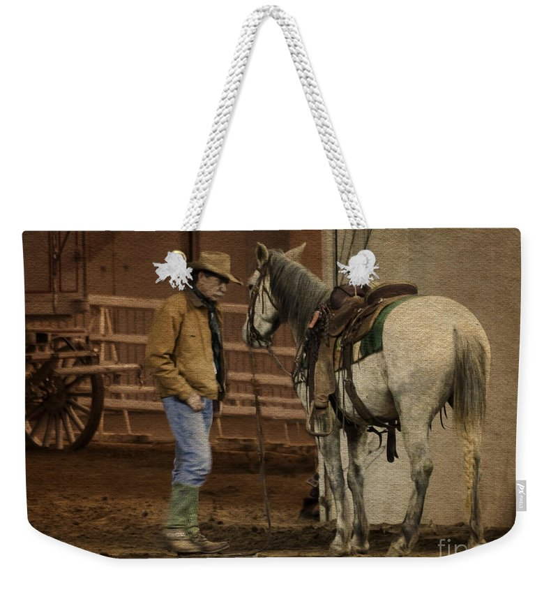Cowboy Weekender Tote Bag featuring the photograph The Mustang Whisperer by Janice Pariza