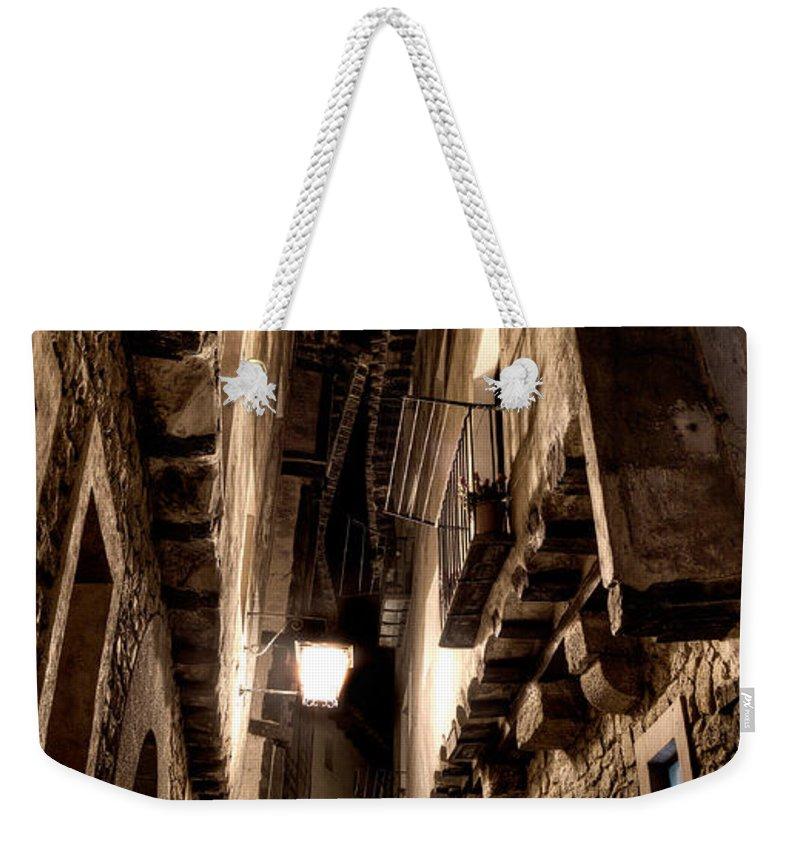 Narrow Street Weekender Tote Bag featuring the photograph Narrow Street In Albarracin by Weston Westmoreland