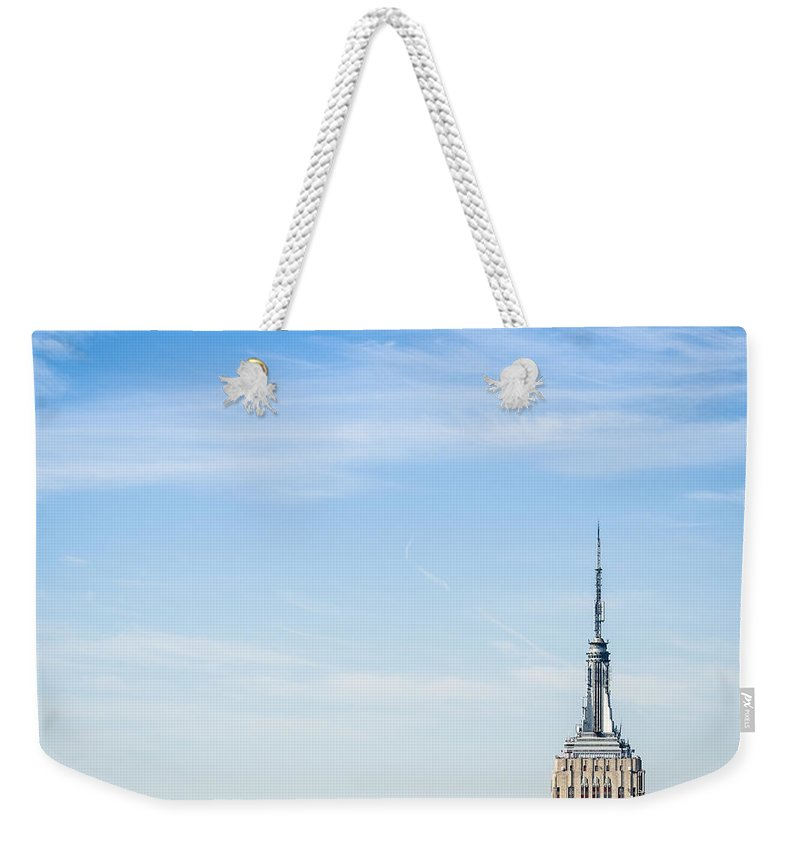 Lower Manhattan Weekender Tote Bag featuring the photograph The New York City Empire State Building by Franckreporter