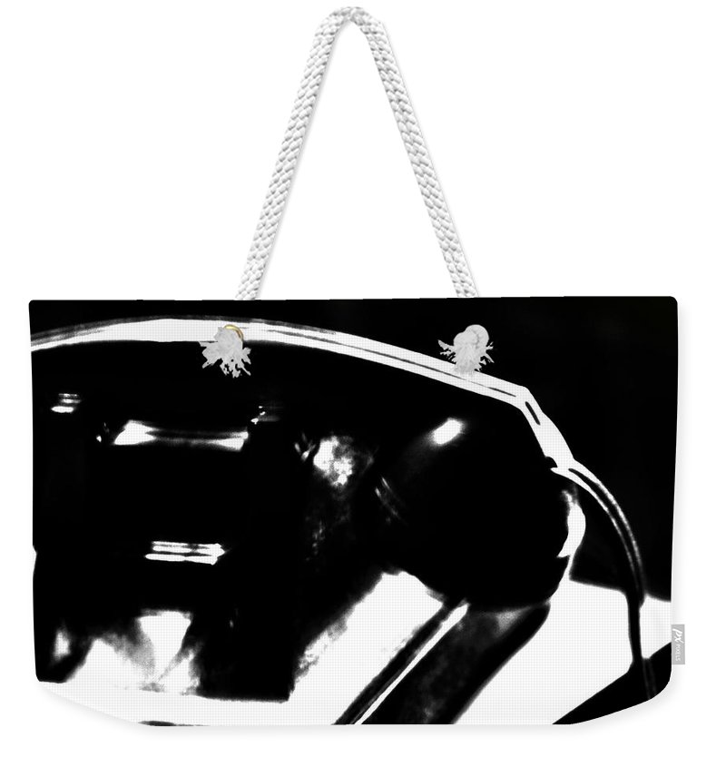 Phone Weekender Tote Bag featuring the photograph The Phones by The Artist Project